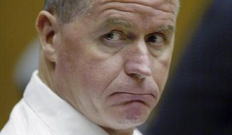 """FILE - In this July 22, 2003 file photo, Fred Weichel, serving a life sentence for a 1980 murder, sits in Middlesex Superior Court in Cambridge, Mass., during a hearing to request a new trial based on a new evidence. Weichel, who has spent more than three decades in prison, is seeking a new trial in February 2014, saying he has corroboration for his claim that convicted gangster James """"Whitey"""" Bulger framed him.  (AP Photo/Julia Malakie, File)"""