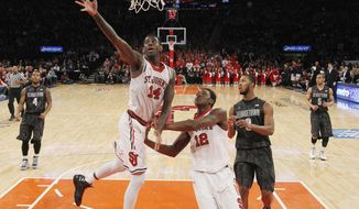 St. John's forward Jakarr Sampson (14) goes for a rebound in front of St. John's center Chris Obekpa (12) during the first half of an NCAA college basketball game against Georgetown at Madison Square Garden in New York, Sunday, Feb. 16, 2014.  (AP Photo/Kathy Willens)