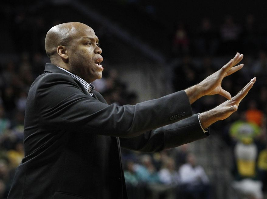 Oregon State head coach Craig Robinson signals to his team during the second half of an NCAA college basketball game against Oregon in Eugene, Ore., Sunday, Feb. 16, 2014. (AP Photo/Chris Pietsch)