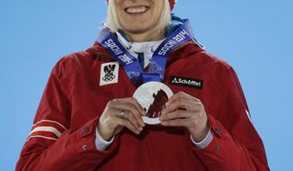 Women's normal hill ski jumping silver medalist Daniela Iraschko-Stolz of Austria smiles during the medals ceremony at the 2014 Winter Olympics, Wednesday, Feb. 12, 2014, in Sochi, Russia. (AP Photo/Morry Gash)