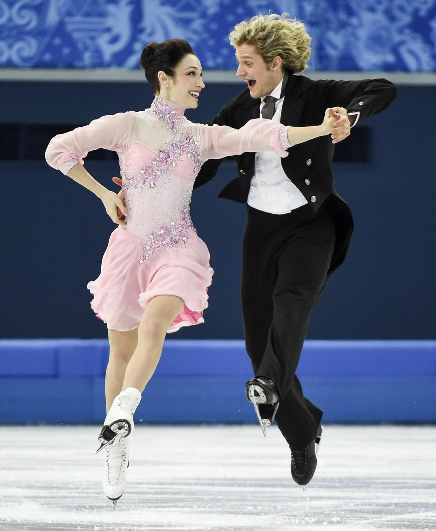 Meryl Davis, left, and Charlie White, of the United States, compete in the ice dance short dance figure skating competition at the Iceberg Skating Palace during the Winter Olympics, Sunday, Feb. 16, 2014, in Sochi, Russia. (AP Photo/The Canadian Press, Paul Chiasson)
