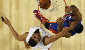 Team Hill's Andre Drummond of the Detroit Pistons (0) dunks the ball against Team Webber's Anthony Davis of the New Orleans Pelicans during the Rising Star NBA All Star Challenge Basketball game, Friday, Feb. 14, 2014, in New Orleans. (AP Photo/Gerald Herbert)