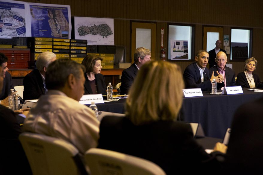 President Barack Obama, third from left, speaks during a roundtable with community leaders including California Gov. Jerry Brown, and Sen. Barbara Boxer, D-Calif., right, at San Luis Water Facility in Firebaugh, Calif., Friday, Feb. 14, 2014, regarding the ongoing drought.  (AP Photo/Jacquelyn Martin)