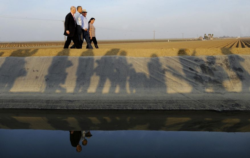 President Barack Obama walks with California Governor Jerry Brown, left and Joe and Maria Gloria Del Bosque, right while touring Empresas Del Bosque farm addressing California's drought situation Friday, Feb. 14, 2014 in Los Banos, Calif. Farmers in California's drought-stricken Central Valley said the financial assistance President Barack Obama delivered on his visit Friday does not get to the heart of California's long-term water problems. (AP Photo/Los Angeles Times, Wally Skalij, Pool)