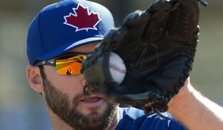 Toronto Blue Jays pitcher Brandon Morrow catches a ball during a fielding drill on the first official day of spring training on Monday, Feb. 17, 2014, in Dunedin, Fla. (AP Photo/The Canadian Press, Frank Gunn)