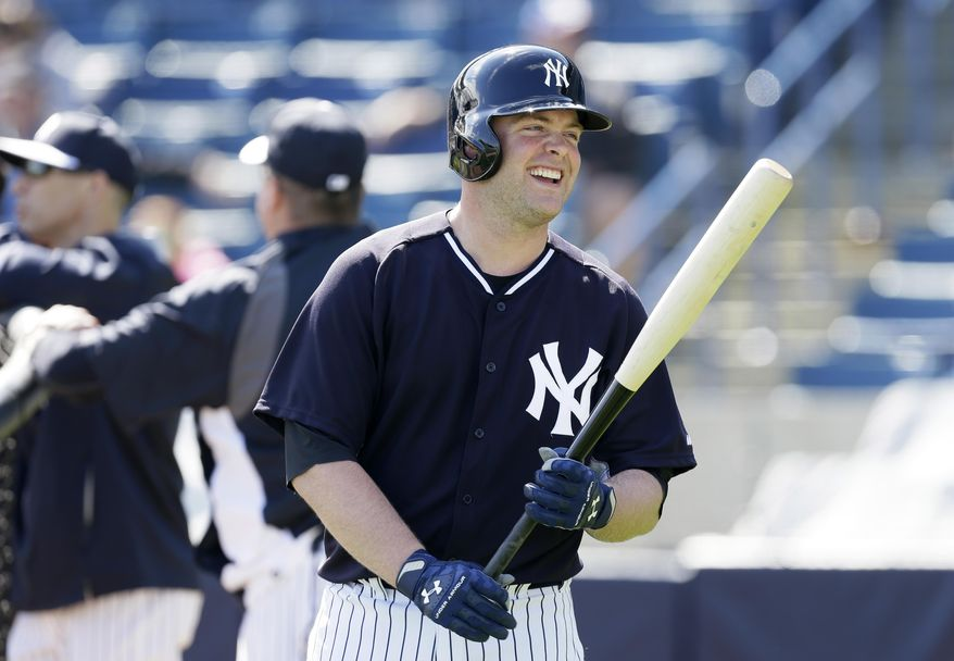 New York Yankees catcher Brian McCann waits to hit in the batting cage during spring training baseball practice Saturday, Feb. 15, 2014, in Tampa, Fla. (AP Photo/Charlie Neibergall)