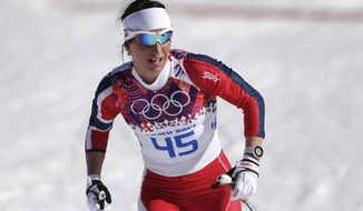 Norway's Marit Bjoergen arrives in the finish during the women's 10K classical-style cross-country race at the 2014 Winter Olympics, Thursday, Feb. 13, 2014, in Krasnaya Polyana, Russia. (AP Photo/Matthias Schrader)