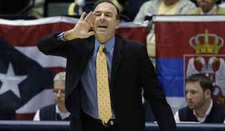 George Washington coach Mike Lonergan shouts to his him team during an NCAA college basketball game against Massachusetts at the Smith Center in Washington, Saturday, Feb. 15, 2014. (AP Photo/Susan Walsh)