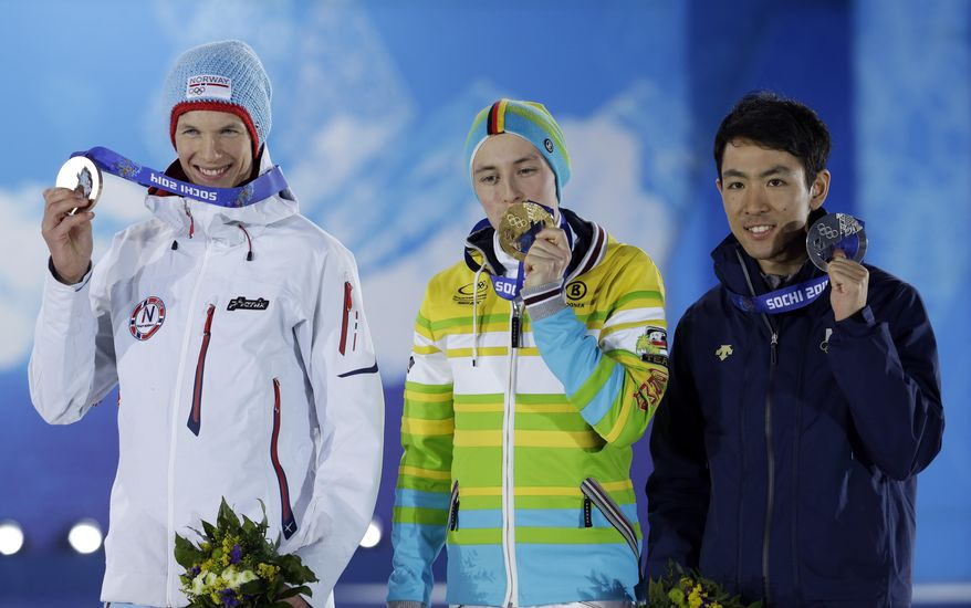 Medal winners in the men's normal hill nordic combined, from left, Norway's Magnus Krog, bronze, Germany's Eric Frenzel, gold, and Japan's Akito Watabe, silver, pose with their medals at the 2014 Winter Olympics in Sochi, Russia, Thursday, Feb. 13, 2014. (AP Photo/Morry Gash)