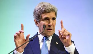 ** FILE ** Secretary of State John Kerry gestures during a speech on climate change on Sunday, Feb. 16, 2014, in Jakarta. (AP Photo/ Evan Vucci, Pool)