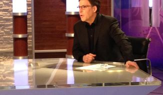 In a photo provided by NBC Olympics, NBC's Bob Costas prepares for broadcast at an anchor desk in Sochi, Russia, Sunday, Feb. 16, 2014. Costas plans to make his return to NBC on Monday after being off the air for a week with an eye infection. (AP Photo/NBC Olympics)