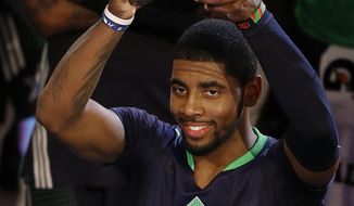 East Team's Kyrie Irving, of the Cleveland Cavaliers holds the All Star MVP trophy after the NBA All Star basketball game, Sunday, Feb. 16, 2014, in New Orleans.(AP Photo/Bill Haber)