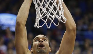 Kansas forward Perry Ellis dunks during the first half of an NCAA college basketball game against TCU in Lawrence, Kan., Saturday, Feb. 15, 2014. (AP Photo/Orlin Wagner)