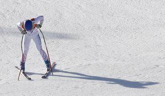 United States' Laurenne Ross pauses after finishing the women's super-G at the Sochi 2014 Winter Olympics, Saturday, Feb. 15, 2014, in Krasnaya Polyana, Russia. (AP Photo/Christophe Ena)