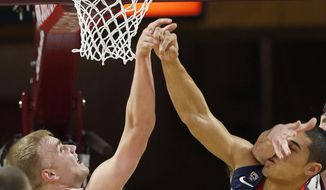 Arizona's Nick Johnson (13) has his shot blocked by Arizona State's Jonathan Gilling (31) and is hit in the face by Arizona State's Jordan Bachynski during the first half of an NCAA college basketball game on Friday, Feb. 14, 2014, in Tempe, Ariz. (AP Photo/Ross D. Franklin)