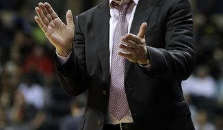 Connecticut head coach Geno Auriemma applauds during the second half of an NCAA college basketball game against South Florida, Sunday, Feb. 16, 2014, in Tampa, Fla. Connecticut won the game 63-38. (AP Photo/Chris O'Meara)