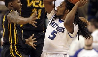 CORRECTS DATE - Saint Louis' Jordair Jett (5) tries to pass around the defense of VCU's Briante Weber (2) and Rob Brandenberg (11) in the first half of an NCAA college basketball game, Saturday, Feb. 15, 2014, in St. Louis.(AP Photo/Tom Gannam)