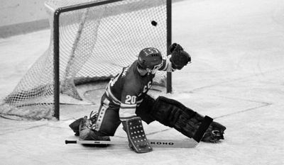 """FILE - In this 1980 file photo, Soviet goalie Vladislav Tretiak allows a goal by the U.S. team in the first period of a medal-round hockey game at the 1980 Winter Olympics in Lake Placid, New York. Tretiak said the U.S. hockey team taught the Soviets a """"good lesson"""" about respecting competitors by beating them in the 1980 Olympics. Tretiak, the three-time Olympic gold medalist, gave up two goals in the first period of the """"Miracle on Ice"""" at the 1980 Lake Placid Olympics and then was benched in what is widely regarded as the greatest upset in Olympic history. (AP Photo, File)"""
