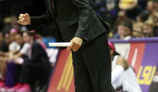 South Carolina head coach Dawn Staley directs her team in the first half of an NCAA college basketball game against LSU in Baton Rouge, La., Sunday, Feb. 16, 2014. (AP Photo/Tim Mueller)