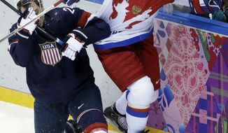 USA forward Ryan Callahan loses his footing against Russia defenseman Andrei Markov in the first period of a men's ice hockey game at the 2014 Winter Olympics, Saturday, Feb. 15, 2014, in Sochi, Russia. (AP Photo/David J. Phillip )