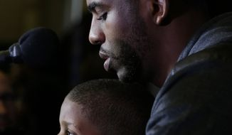 Los Angeles Clippers' Chris Paul holds his son Chris Paul Jr., 4, during the NBA All Star basketball news conference, Friday, Feb. 14, 2014, in New Orleans. The 63rd annual NBA All Star game will be played Sunday in New Orleans.(AP Photo/Gerald Herbert)
