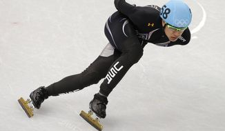J.R. Celski of the United States competes in a men's 1000m short track speedskating heat at the Iceberg Skating Palace during the 2014 Winter Olympics, Thursday, Feb. 13, 2014, in Sochi, Russia. (AP Photo/Darron Cummings)