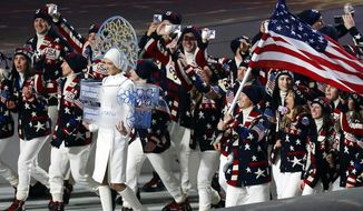 FILE - In this Friday, Feb. 7, 2014 file photo, members of the United States Olympic team _ many of them holding up mobile phones to record the moment _ enter Fisht Stadium in Sochi, Russia, for the opening ceremony of the 2014 Winter Olympics. Picking up new followers on Twitter, Facebook and other social media platforms is the smart play for Olympians at the Sochi Games. Athletes who share their experiences from their privileged backstage access at the games could come home from Russia with far stronger hands to woo and squeeze more money from sponsors. (AP Photo/Petr David Josek, File)