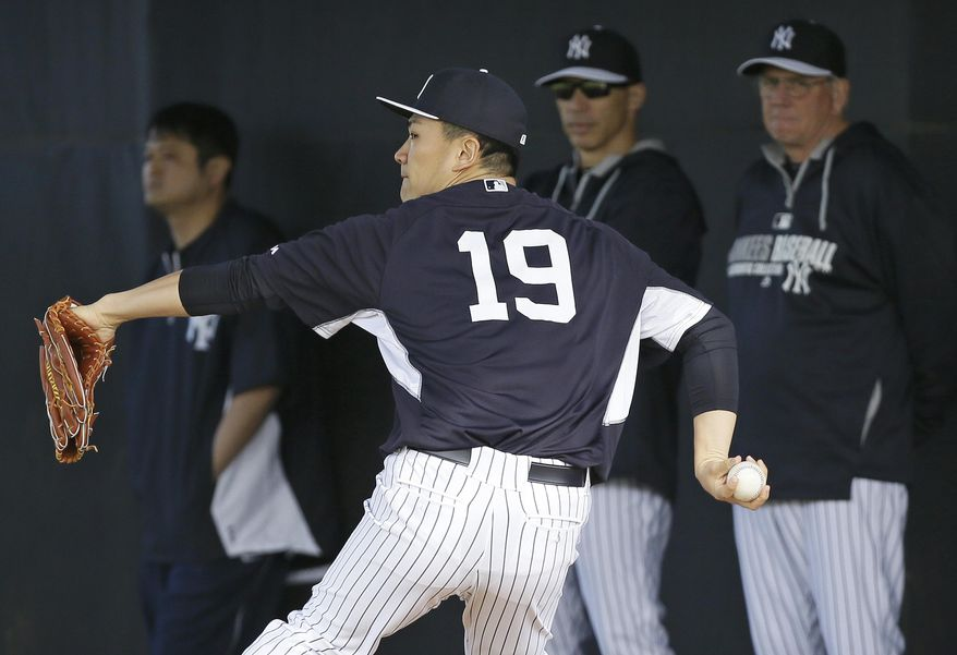 New York Yankees starting pitcher Masahiro Tanaka (19) throws in the bullpen during spring training baseball practice Saturday, Feb. 15, 2014, in Tampa, Fla. (AP Photo/Charlie Neibergall)