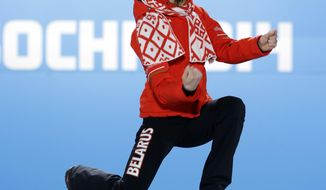 Women's biathlon 15K individual gold medalist Darya Domracheva of Belarus celebrates during the medals ceremony at the 2014 Winter Olympics, Saturday, Feb. 15, 2014, in Sochi, Russia. (AP Photo/David J. Phillip )
