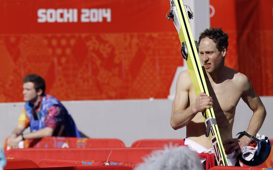Bernhard Gruber of Austria waits in the mixed zone during the ski jumping large hill portion of the men's Nordic combined training at the 2014 Winter Olympics, Saturday, Feb. 15, 2014, in Krasnaya Polyana, Russia. (AP Photo/Gregorio Borgia)
