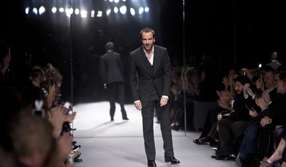Designer Tom Ford takes the applause following his show during London Fashion Week Autumn/Winter 2014, at Lindley Hall in central London, Monday, Feb. 17, 2014. (Photo by Joel Ryan/Invision/AP)