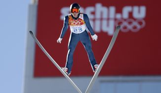 United States' Taylor Fletcher makes his trial jump during the ski jumping portion of the Nordic combined at the 2014 Winter Olympics, Wednesday, Feb. 12, 2014, in Krasnaya Polyana, Russia. (AP Photo/Matthias Schrader)
