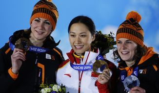 Women's 1,000-meter speedskating medalists, from left, Margot Boer of the Netherlands, bronze, Zang Hong of China, gold, and Ireen Wust of the Netherlands, silver, pose with their medals at the 2014 Winter Olympics in Sochi, Russia, Friday, Feb. 14, 2014. (AP Photo/David J. Phillip )