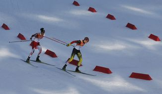 Germany's gold medal winner Eric Frenzel, right, and Japan's silver medal winner Akito Watabe ski during the cross-country portion of the Nordic combined at the 2014 Winter Olympics, Wednesday, Feb. 12, 2014, in Krasnaya Polyana, Russia. (AP Photo/Dmitry Lovetsky)