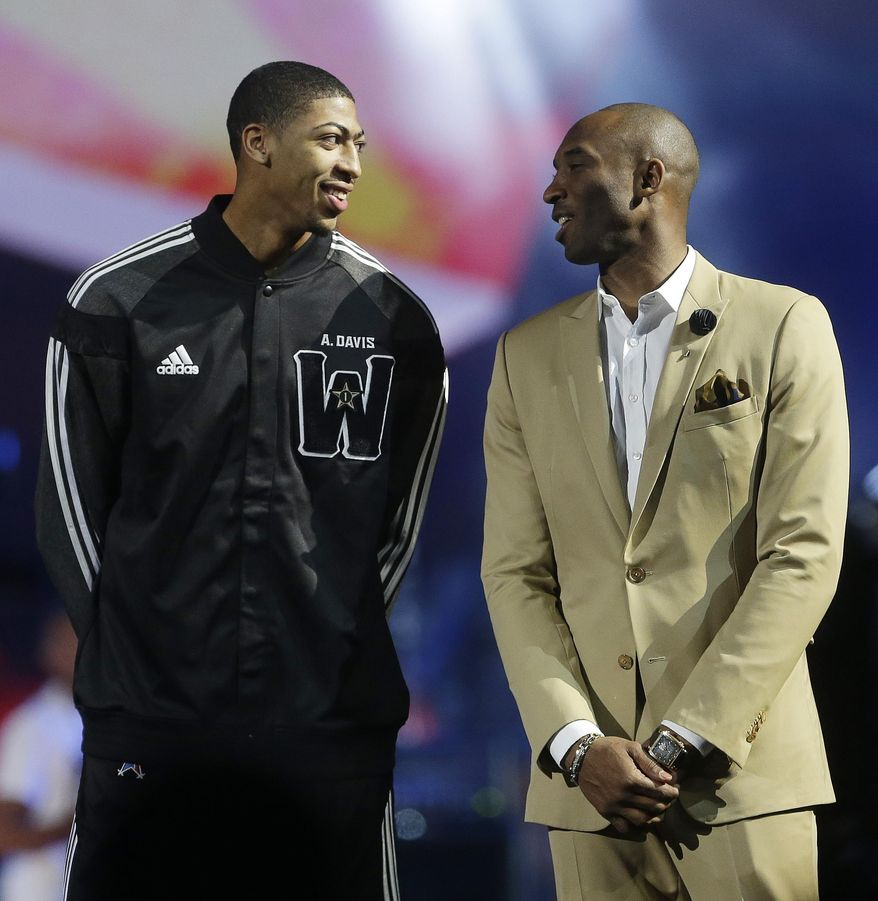 West Team's Anthony Davis, of the New Orleans Pelicans , left, speaks with Los Angeles Lakers Kobe Bryant during the NBA All Star basketball game, Sunday, Feb. 16, 2014, in New Orleans. (AP Photo/Gerald Herbert)
