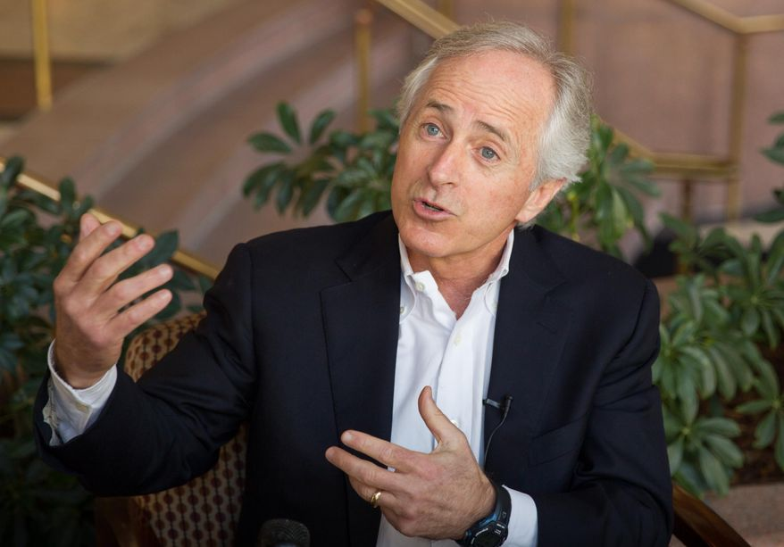 **FILE** Sen. Bob Corker, Tennessee Republican, speaks to reporters in Chattanooga on Feb. 15, 2014. (Associated Press)