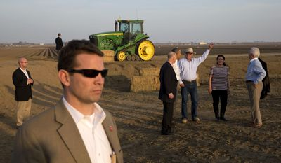 President Barack Obama, second from left in group, tours a local farm with Governor Jerry Brown, left, Joe Del Bosque of Empresas Del Bosque, Inc., and Maria Gloria Del Bosque also of Empresas Del Bosque, Inc.,and Rep. Jim Costa, D-Calif., in Los Banos, Calif., Friday, Feb. 14, 2014, where he spoke about the drought. (AP Photo/Jacquelyn Martin)