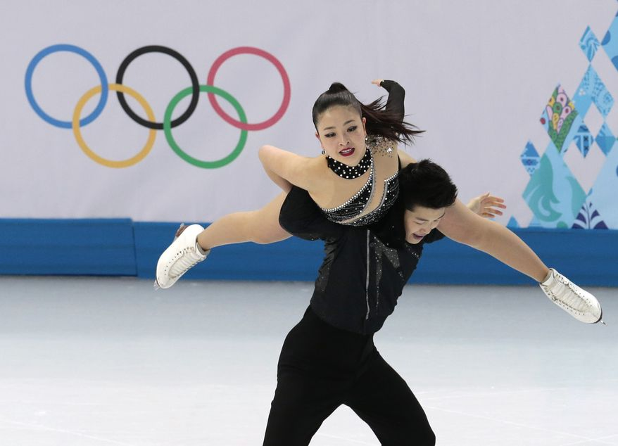 Maia Shibutani and Alex Shibutani of the United States compete in the ice dance free dance figure skating finals at the Iceberg Skating Palace during the 2014 Winter Olympics, Monday, Feb. 17, 2014, in Sochi, Russia. (AP Photo/Ivan Sekretarev)