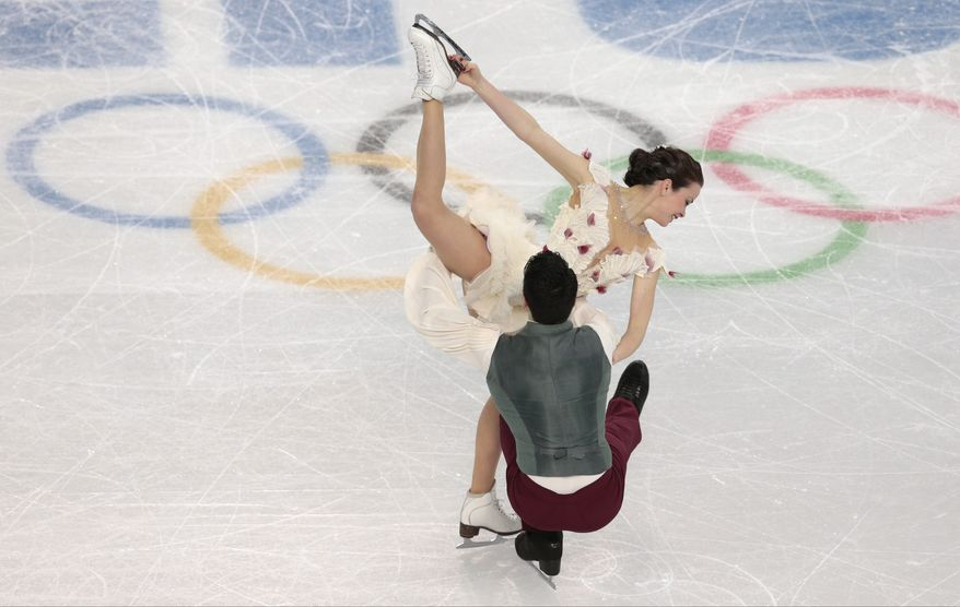 Anna Cappellini and Luca Lanotte of Italy compete in the ice dance free dance figure skating finals at the Iceberg Skating Palace during the 2014 Winter Olympics, Monday, Feb. 17, 2014, in Sochi, Russia. (AP Photo/Ivan Sekretarev)