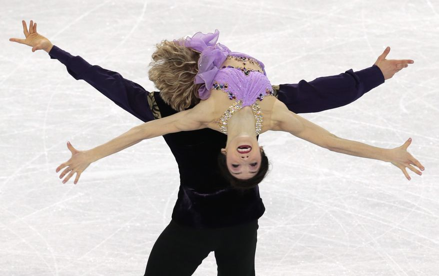 Meryl Davis and Charlie White of the United States compete in the ice dance free dance figure skating finals at the Iceberg Skating Palace during the 2014 Winter Olympics, Monday, Feb. 17, 2014, in Sochi, Russia. (AP Photo/Ivan Sekretarev)