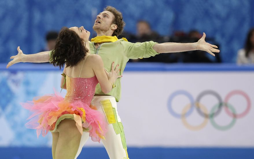 Nathalie Pechalat and Fabian Bourzat of France compete in the ice dance free dance figure skating finals at the Iceberg Skating Palace during the 2014 Winter Olympics, Monday, Feb. 17, 2014, in Sochi, Russia. (AP Photo/Darron Cummings)
