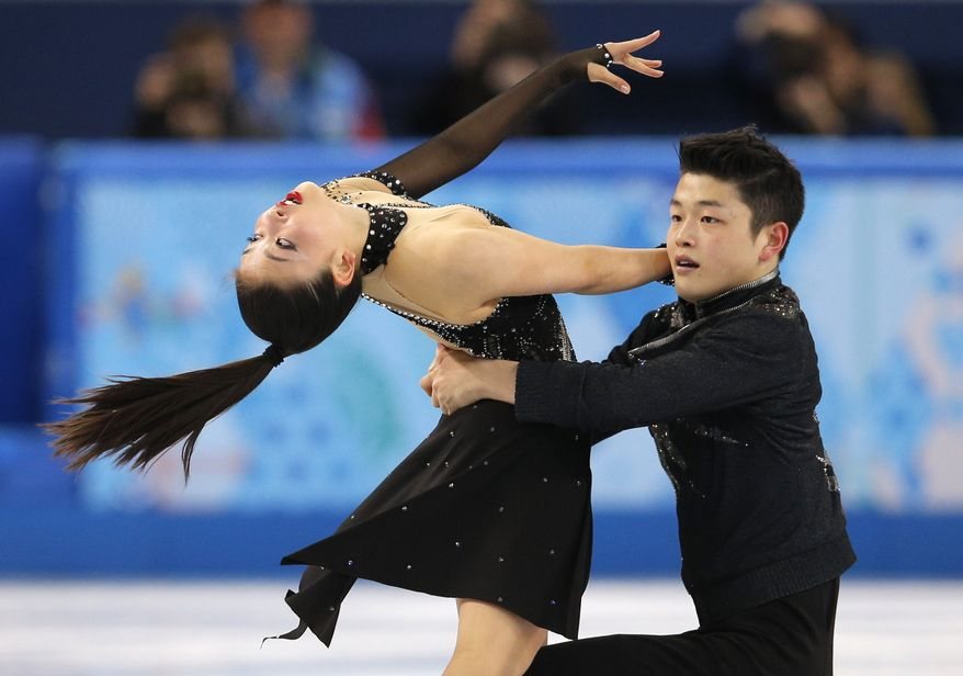Maia Shibutani and Alex Shibutani of the United States compete in the ice dance free dance figure skating finals at the Iceberg Skating Palace during the 2014 Winter Olympics, Monday, Feb. 17, 2014, in Sochi, Russia. (AP Photo/Vadim Ghirda)