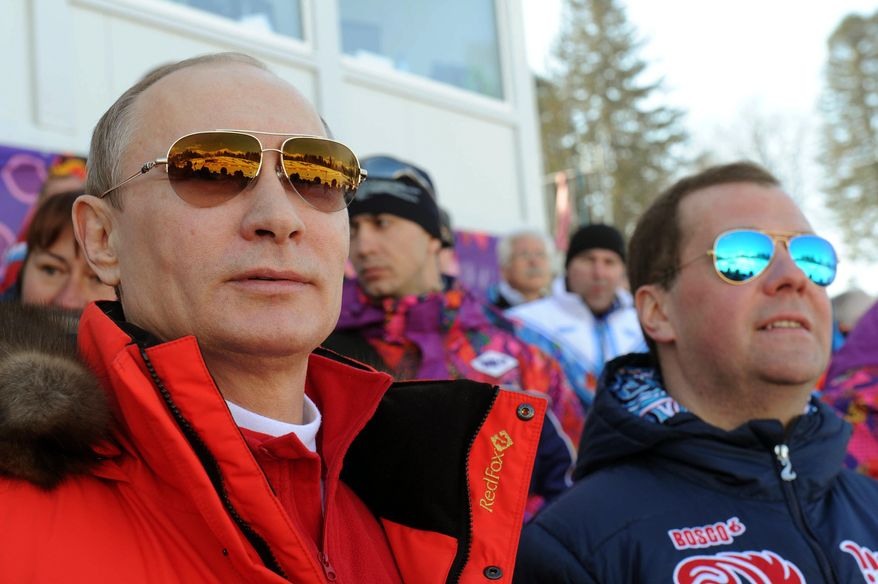 ** FILE ** In this Feb. 16, 2014 file photo, Russian President Vladimir Putin, left, and Premier Dmitry Medvedev watch the men's 4x10 km cross-country relay at the 2014 Winter Olympics in Krasnaya Polyana, Russia. (AP Photo/RIA-Novosti, Mikhail Klimentyev, Presidential Press Service)