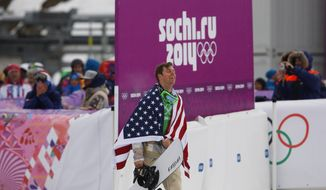 Bronze medalist Alex Deibold of the United States walks to a flower ceremony after the men's snowboard cross final at the Rosa Khutor Extreme Park, at the 2014 Winter Olympics, Tuesday, Feb. 18, 2014, in Krasnaya Polyana, Russia.(AP Photo/Sergei Grits)