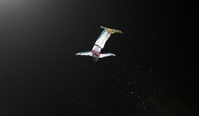 Silver medal winner, Australia's David Morris makes his final jump during men's freestyle skiing aerials at the Rosa Khutor Extreme Park, at the 2014 Winter Olympics, Monday, Feb. 17, 2014, in Krasnaya Polyana, Russia. (AP Photo/Andy Wong)