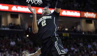 Wake Forest forward Devin Thomas (2) goes to the basket against Maryland guard Nick Faust (5) during the first half of an NCAA college basketball game, Tuesday, Feb. 18, 2014, in College Park, Md. (AP Photo/Nick Wass)