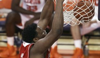 North Carolina State's BeeJay Anya dunks against Clemson during the first half of an NCAA college basketball game Tuesday, Feb. 18, 2014, at Littlejohn Coliseum in Clemson, S.C. (AP Photo/Anderson Independent-Mail, Ken Ruinard) GREENVILLE NEWS OUT, SENECA JOURNAL OUT