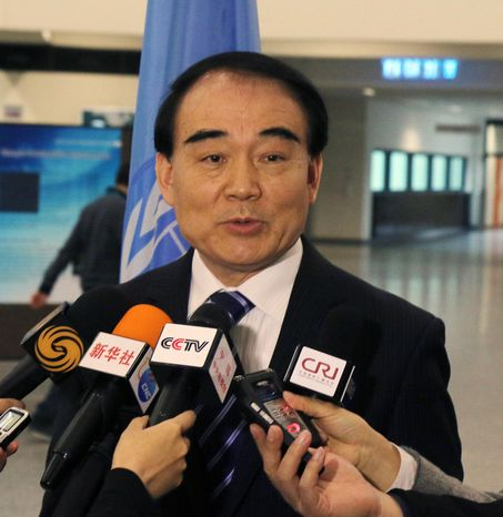 Li Baodong China's Vice Minister of Foreign Affairs speaks to media during closed-door nuclear talks in Vienna, Austria, Tuesday, Feb. 18, 2014. Iran and six world powers are back at the negotiating table eager to come to terms on a comprehensive nuclear deal but deeply divided on what it should look like. The two sides began meeting Tuesday in attempts to build on a first-step accord that temporarily curbs Tehran's nuclear activities in exchange for some sanctions relief. (AP Photo/Ronald Zak)