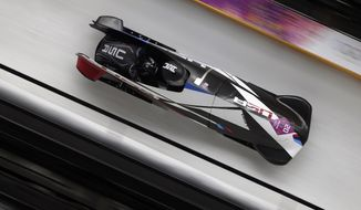 The team from the United States USA-1, piloted by Elana Meyers with brakeman Lauryn Williams, speed down the track during the women's two-man bobsled competition at the 2014 Winter Olympics, Tuesday, Feb. 18, 2014, in Krasnaya Polyana, Russia. (AP Photo/Michael Sohn)