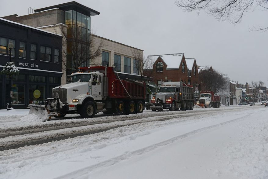 Snow plows clear M St. in Northwest Washington, D.C., on Thursday, February 13, 2014. (Lloyd Villas/The Washington Times).